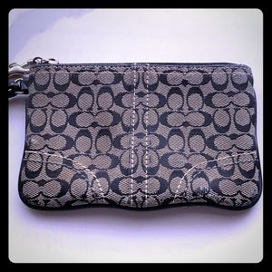 Chic black and grey coach wristlet🔥
